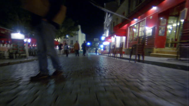 point of view narrow cobblestone streets of montmartre / paris, france - pedestrian zone stock videos & royalty-free footage