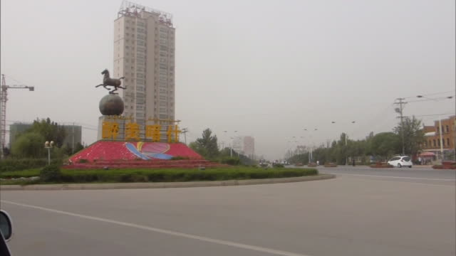 point of view of a car driving through a multilane road with a few cars around; a large sign of kashgar in chinese character seen standing in the... - median nerve stock videos & royalty-free footage