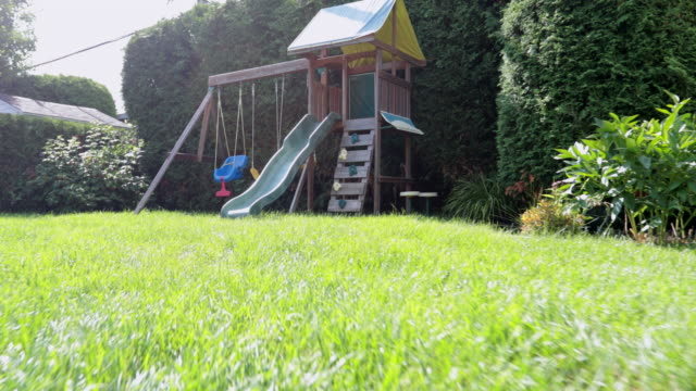 pov point of view of a kid running to playground - lawn stock videos & royalty-free footage