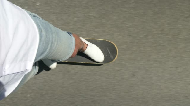 point of view of a man skateboarding - skateboard stock videos and b-roll footage