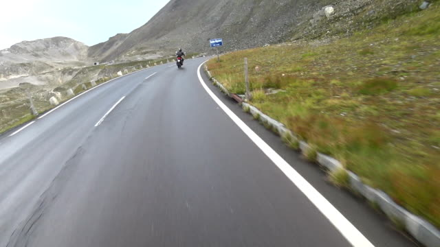 point of view of a motorcycle on mountain road in austria - mountain road stock videos & royalty-free footage
