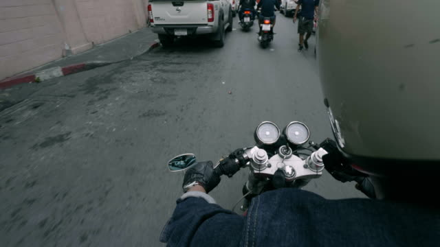 point of view of a motorcycle rider rides - motorbike stock videos & royalty-free footage