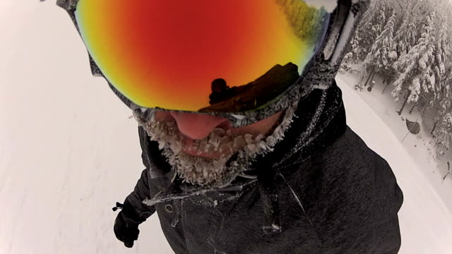 point of view of a snowboarder in powder snow - ski goggles stock videos & royalty-free footage