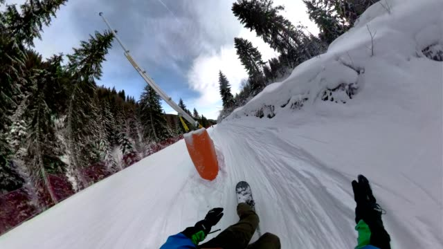 point of view of a snowboarder riding down a ski piste - fish eye lens stock videos & royalty-free footage