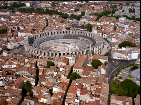 aerial point of view of amphitheater (arenes) in center of village / arles, provence, france - amphitheatre stock videos & royalty-free footage