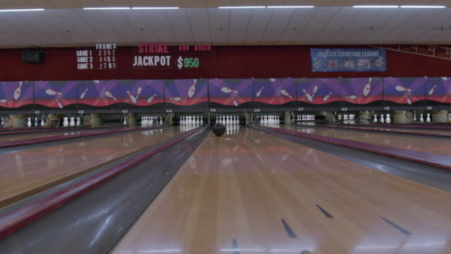 point of view of bowling ball striking bowling pins - bowling ball stock videos & royalty-free footage