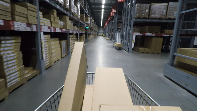 point of view of boxes moving through a large warehouse - cardboard box stock videos & royalty-free footage
