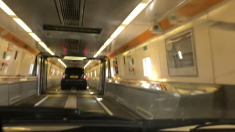 point of view of car driving and boarding the eurotunnel train in france - eurotunnel folkestone stock-videos und b-roll-filmmaterial