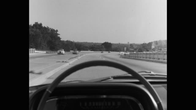 stockvideo's en b-roll-footage met point of view of cars driving on highway - auto interieur