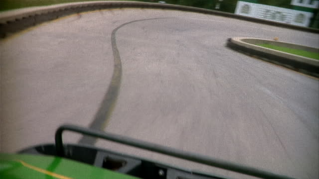 point of view of go-cart driver racing around bends in track - go cart stock videos & royalty-free footage