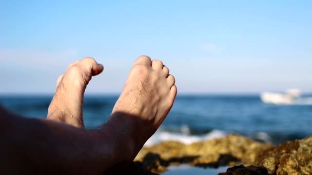 Point of view of man lying down on the beach