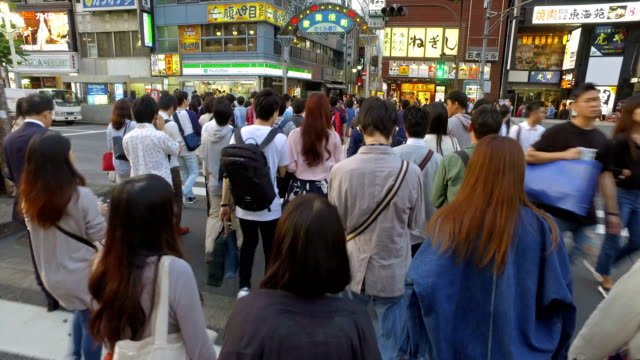 Point of view of people crossing the street in Shinjuku, Tokyo