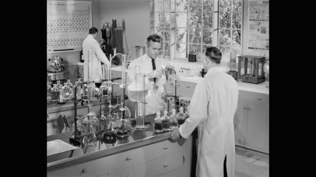 point of view of scientists doing experiment in laboratory - chemistry stock videos & royalty-free footage