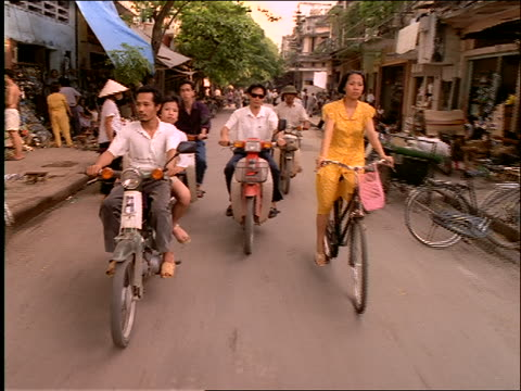 point of view on city street with bikes, mopeds + pedicabs / vietnam - vietnam stock videos & royalty-free footage
