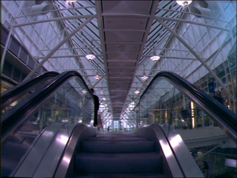 point of view on escalator in munich airport - 1992 stock-videos und b-roll-filmmaterial