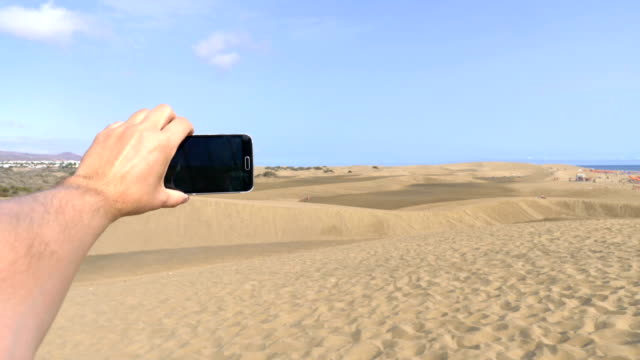 Point of view on the taking a selfie photo in Maspalomas dunes Grand Canary in 4K