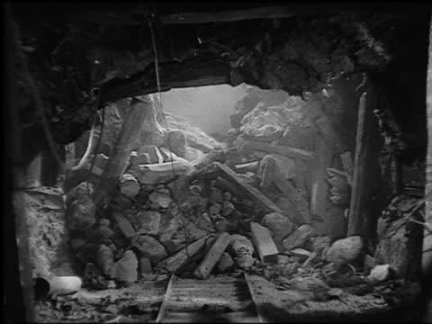"""vídeos de stock, filmes e b-roll de b/w 1935 rear point of view on track through exploding mine shaft (model) / """"black fury"""" - mina de carvão"""