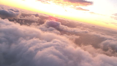 aerial point of view over clouds with sunset on horizon - aircraft point of view stock videos & royalty-free footage