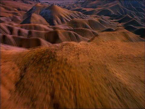 aerial point of view over desert mountains/sand dunes + valleys / utah - ユタ州点の映像素材/bロール