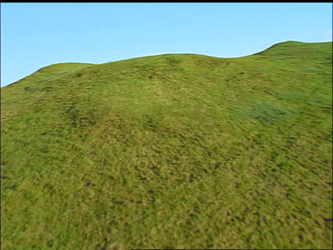aerial point of view over green hill with woman in black dress + hat walking on top / oban, argyll, scotland - black dress stock videos & royalty-free footage