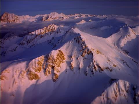 aerial point of view over snowy mountains / utah - ユタ州点の映像素材/bロール