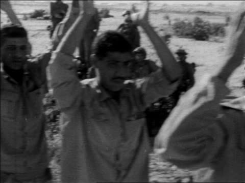 b/w 1967 point of view past line of egyptian prisoners of war raising arms / six day war / newsreel - sechstagekrieg stock-videos und b-roll-filmmaterial