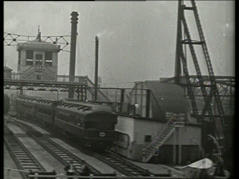 b/w point of view past parked train on train tracks / no sound - 操車場点の映像素材/bロール