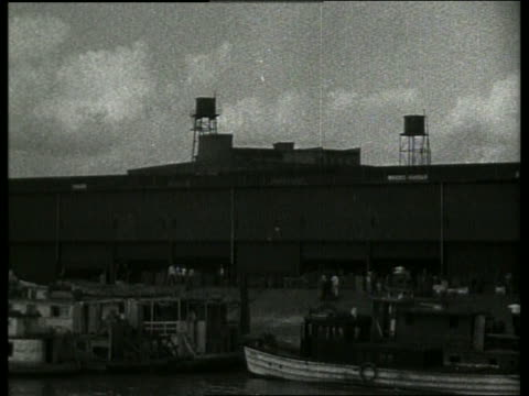 B/W point of view past warehouses on docks / New Orleans / 1910 / NO SOUND