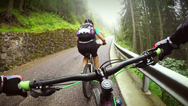 point of view pedalling on mountainbike with girl - bicycle trail outdoor sports stock videos & royalty-free footage