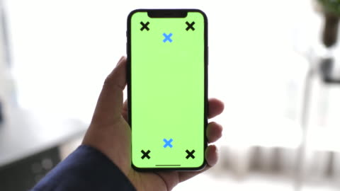 point of view people looking on smart phone with green screen handheld smartphone - human hand stock videos & royalty-free footage