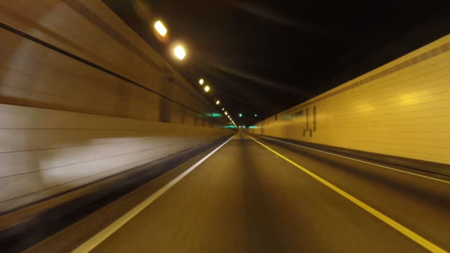 point of view perspective of driving into tunnel - tunnel stock videos & royalty-free footage
