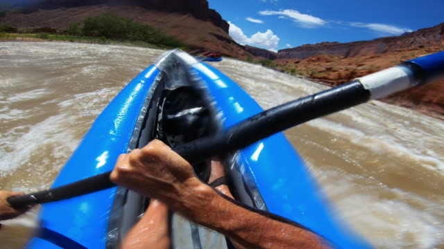 pov point of view rafting with kayak in rough colorado river, moab - moab utah stock videos & royalty-free footage