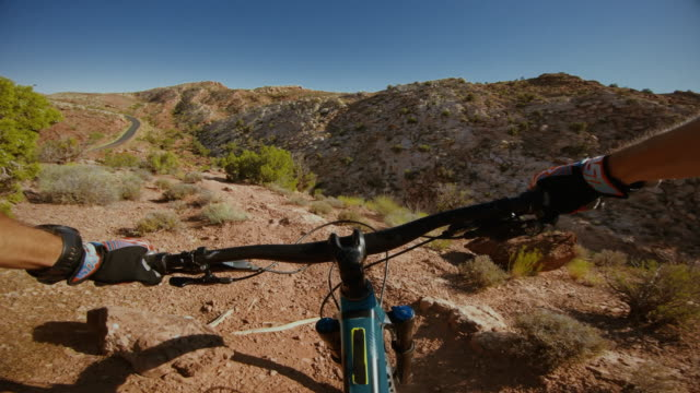 point of view pov riding mountain bike in moab, utah - moab utah stock videos & royalty-free footage