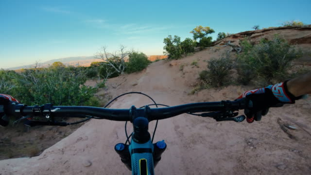 point of view pov riding mountain bike in moab, utah - point of view stock videos & royalty-free footage