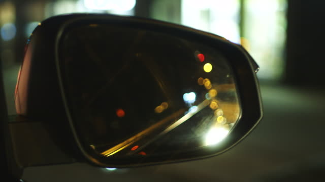 Point of view shot, car side-view mirror, New York City