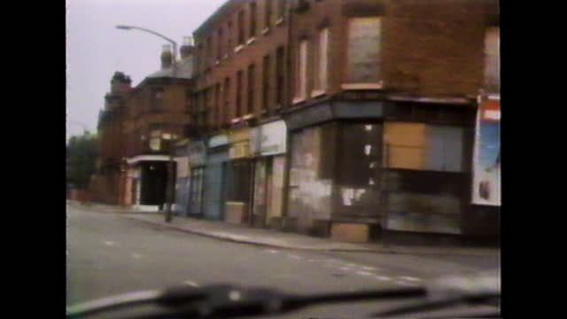 point of view shot from a car driving through streets of toxteth in liverpool showing buildings damaged by recent riots during the 1981 toxteth riots. - recession stock videos & royalty-free footage