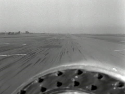 vidéos et rushes de point of view shot from the cockpit of an raf canberra aircraft as it comes into land. 1953. - aircraft point of view