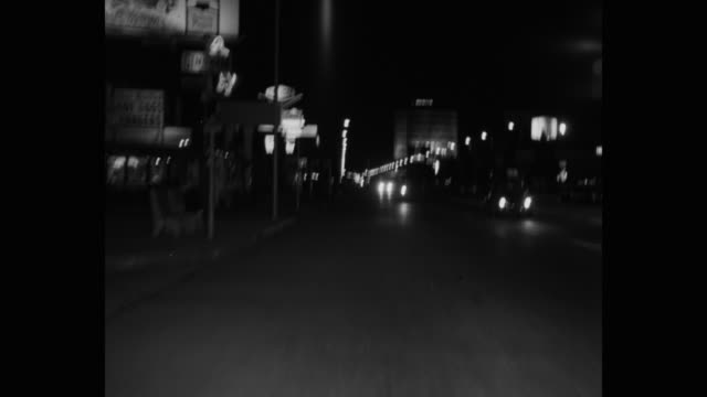point of view shot of cars driving on street at night, wilshire boulevard, los angeles, california, usa - 1965 stock videos & royalty-free footage