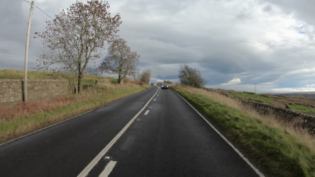 point of view shot of driving through the a6079 road - pasture stock videos & royalty-free footage