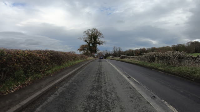 point of view shot of driving through the front street near brunton turret - pasture stock videos & royalty-free footage