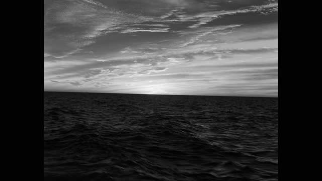 point of view shot of sunrise over sea seen from moving submarine - orizzonte video stock e b–roll