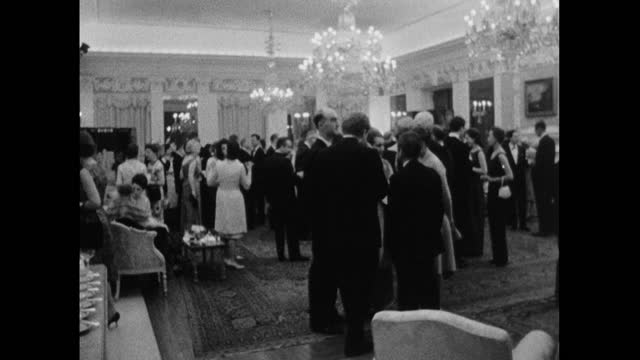 point of view shot walking into a formal party held by the uk ambassador in the british embassy in washington dc; usa, 964. - ornate stock videos & royalty-free footage