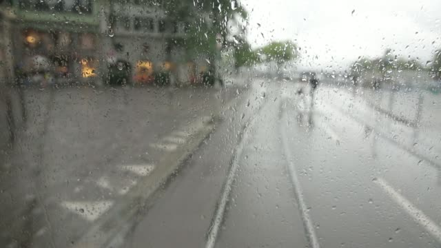 point of view shots filmed from the rear of a tram carriage during journeys along city streets between station stops on a rainy day in zurich... - tram point of view stock videos and b-roll footage