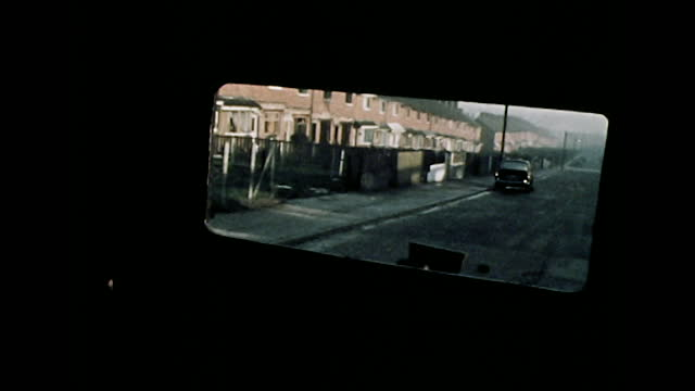 point of view shots from a british armoured vehicle as it patrols the ardoyne district of belfast; 1971. - car point of view stock videos & royalty-free footage