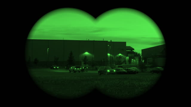 point of view through a military spy binoculars on a parking lot - binoculars stock videos & royalty-free footage
