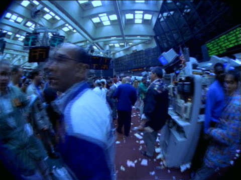BLUE FISHEYE point of view traders working on littered floor of Coffee, Sugar + Cocoa Exchange, NYC