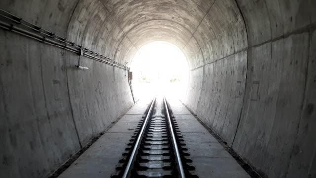 stockvideo's en b-roll-footage met standpunt trein uit tunnel. - the end
