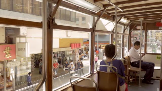 vídeos de stock, filmes e b-roll de point of view traveling inside a tram in hong kong - ponto de vista de bonde
