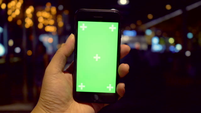 point of view using smart phone green screen at night - point of view stock videos & royalty-free footage
