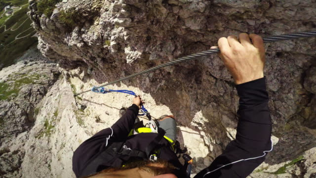 point of view video: via ferrata on the alps - stepping stone stock videos & royalty-free footage